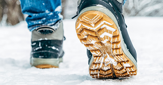 Remove the snow from the soles of your shoes